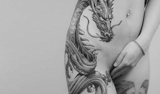 Full-body dragon piece by @ezer.artwork 
